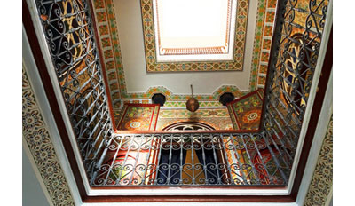 view to the top of a moroccan house with rugs showing